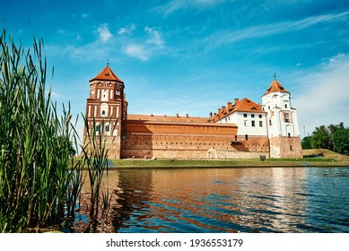 Mir castle complex in a summer day with blue cloudy sky. Tourism landmark in Belarus, cultural monument, old fortress - Shutterstock ID 1936553179