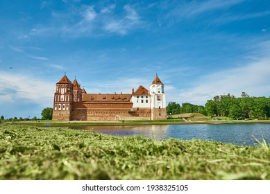 Mir castle complex in a summer day with blue cloudy sky. Tourism landmark in Belarus, cultural monument, old fortress - Shutterstock ID 1938325105