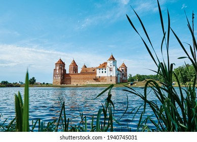 Mir castle complex in a summer day with blue cloudy sky. Tourism landmark in Belarus, cultural monument, old fortress - Shutterstock ID 1940745031