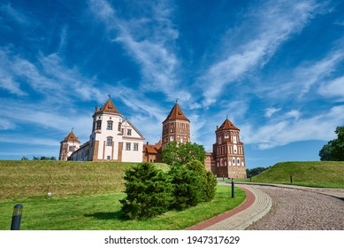 Mir castle complex in a summer day with blue cloudy sky. Tourism landmark in Belarus, cultural monument, old fortress - Shutterstock ID 1947317629