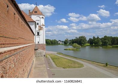 "The Mir Castle. The Grodno region. Belarus. 06/18/2016. The castle complex ""Mir"". View of the Mir lake from Mir Castle. Picturesque landscape."