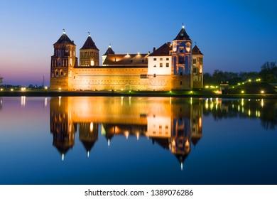 Mir Castle in the night landscape. Mir, Belarus
