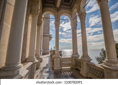 MIRA MARE CASTLE, TRIEST, FRIULI VENEZIA GIULIA, ITALIA - MARCH 2018: view of Mira mare Castle in Trieste, gentle sunset through the columns of the white marble pavilion