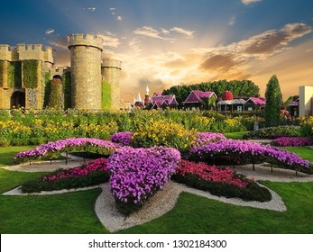 Miracle formal garden with over 45 million flowers and castle architecture in sunset light, Dubai, UAE