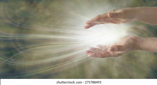 Miracles Happen - pair of parallel female healer's hands with an intricate white light energy formation between on a wide muted gold background with plenty of copy space