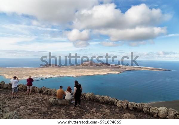 Mirador del Rio, Lanzarote (Canary Islands, Spain) circa november 2016. A group of tourists visit the Mirador del Rio in Lanzarote to look at the neighborg island of La Graciosa during their holidays
