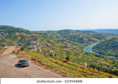 Miradouro de Sao Silvestre Viewpoint, Douro Valley, Portugal - September 2nd 2018: Grey car on the top of the viewpoint over beautiful vineyard landscape along the Douro river.