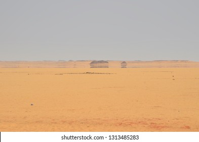 A mirage is a naturally occurring optical phenomenon in which light rays bend to produce a displaced image of distant objects or the sky. Mirage at Arabian Desert.