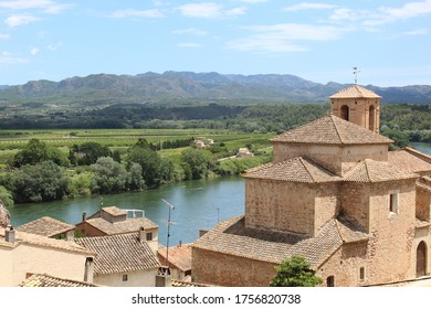 Miravet, Tarragona / Spain - June 14 2020: Panoramic view on the old stone church in the village of Miravet, captured from the top of the hill