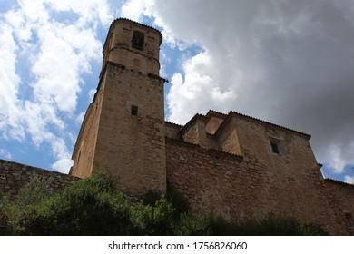 Miravet, Tarragona / Spain - June 14 2020: Worm's eye view on the old stone church of Miravet