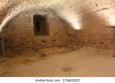 Miravet, Tarragona / Spain - June 14 2020: Old stone walls and remains inside the medieval castle, captured in the village of Miravet