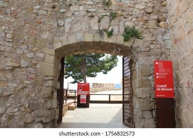 Miravet, Tarragona / Spain - June 14 2020: Close up on the entrance gate of the medieval castle in Miravet