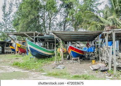 MIRI, SARAWAK, EAST MALAYSIA.  August 21, 2016: Small colorful fishing boats parked on a dry dock in Miri, Sarawak, East Malaysia.