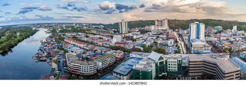 Miri, Sarawak, Malaysia - December 03 2018: Panoramic view of Miri City taken at golden hour