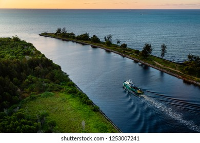 Miri, Sarawak, Malaysia - December 4 2018: An offshore supply vessel leaves Miri Harbour in the evening on its way to the Miri Oilfields