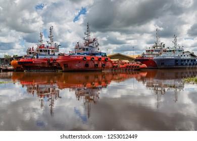 Miri, Sarawak, Malaysia - December 4 2018: Offshore supply vessels in Miri Harbour, such as DANUM 119, DANUM 169, SEALINK MAJU and VANESSA 17.