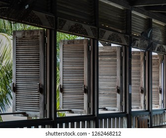 Miri, Sarawak, Malaysia - December 5 2018: Window blinds of the intricately carved wooden event hall of Coco Cabana Miri.
