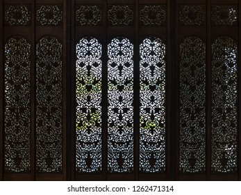 Miri, Sarawak, Malaysia - December 5 2018: Carved screen door in the intricately carved wooden event hall of Coco Cabana Miri.