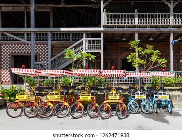 Miri, Sarawak, Malaysia - December 5 2018: Bike rental in front of the intricately carved wooden event hall of Coco Cabana Miri .
