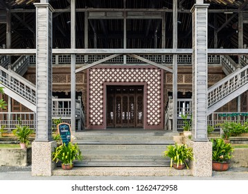 Miri, Sarawak, Malaysia - December 5 2018: The main entrance of the intricately carved wooden event hall of Coco Cabana Miri.