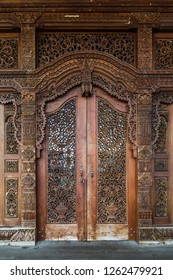 Miri, Sarawak, Malaysia - December 5 2018: A door of the intricately carved wooden event hall of Coco Cabana Miri.
