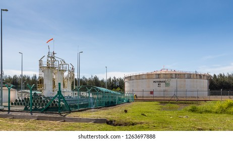 Miri, Sarawak, Malaysia - December 5 2018: Gas drying and metering unit and a flat bottom storage tank of Petronas at their MCOT site (Miri Crude Oil Terminal) in Lutong