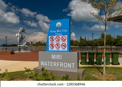 """Miri, Sarawak, Malaysia - December 5 2018: """"Keep Miri City Clean"""" commitment at Miri Waterfront. The Seahorse sculpture - the official town mascot - in the background."""