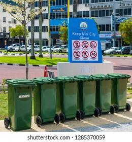 "Miri, Sarawak, Malaysia - December 5 2018: ""Keep Miri City Clean"" commitment sign at Miri Waterfront with five green garbage bins."
