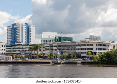 Miri, Sarawak, Malaysia - December 5 2018: Miri Waterfront with the seahorse sculpture, seen from the opposite site of Baong River. Big building left: Mega Hotel. Right: Sarawak Plantation Head Office