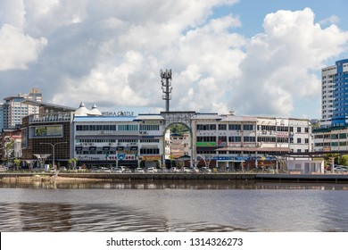 Miri, Sarawak, Malaysia - December 5 2018: Miri Waterfront and Wisma Castle with its huge gate, seen from the opposite site of Baong River at Pulau Melayu. The big building on right is the Mega Hotel.