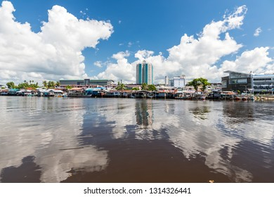 Miri, Sarawak, Malaysia - December 5 2018: Miri Waterfront, seen from the opposite site of Baong River at Pulau Melayu. The big building is the Mega Hotel.