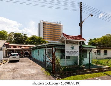 Miri, Sarawak, Malaysia - December 5 2018: Department of Agriculture of Miri District. In the background: Wisma Pelita Tunku, an older shopping complex and office building.