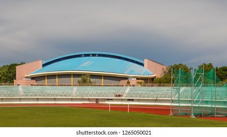Miri, Sarawak, Malaysia - December 6 2018: Miri Stadium and the blue roofed Miri Indoor Stadium, both part of the Miri Sports Complex