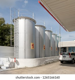 Miri, Sarawak, Malaysia - December 6 2018: Cylindrical, standing flat bottom storage tanks for petrol and diesel at a Shell Fuel Station