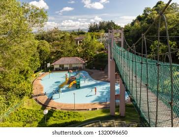 Miri, Sarawak, Malaysia - December 6 2018: Children pool, seen from the suspension brdge of the Public Park Miri (malay: Taman Awam Miri)