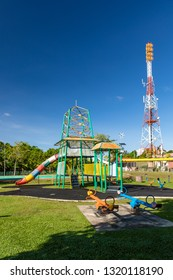 Miri, Sarawak, Malaysia - December 6 2018: Children playground at Public Park Miri (malay: Taman Awam Miri) and communication tower