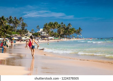 Mirissa Beach, Sri Lanka - JAN 3, 2017:  Tourists walking on the sand while enjoying the view across the wonderful beach of Mirissa on Jan 3, 2017. Sri Lanka.