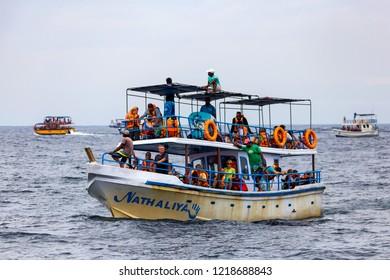 MIRISSA, SRI LANKA - 5 DECEMBER 2013: Boat of whale watching tourists in Mirissa, Sri Lanka.