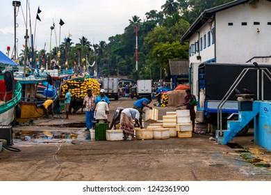 MIRISSA, SRI LANKA - 5 DECEMBER 2013: People and boats in pier of Mirissa, Sri Lanka
