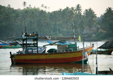Mirissa, Sri Lanka - April 19th 2011: Early morning in the port of Mirissa - After the fishermen have off-loaded their trawlers, they anchor them in the port until next day