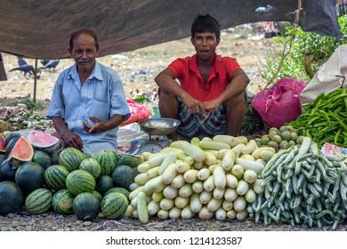 MIRISSA, SRI LANKA - AUGUST 04, 2012 : Men selling a variety of fresh fruit and vegetables at a roadside market at Mirissa in southern Sri Lanka.