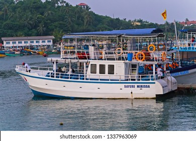 Mirissa, Sri Lanka - February 12, 2016: Sri Lanka Tourists boats in the Mirissa harbor, Boat Tours tourist attraction Mirissa Whale Watching Vessel of the island.