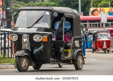 MIRISSA, SRI LANKA - January 01, 2017: Tuk-tuk moto taxi on the street. Famous thai moto-taxi called tuk-tuk is a landmark of the country and popular transport.