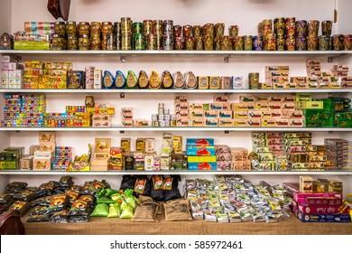 MIRISSA, SRI LANKA - January 11, 2017: Wide range of traditional Ceylon tea on wooden shelves at tea shop in the Mirissa town in Sri Lanka.