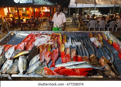 MIRISSA, SRI LANKA, MARCH 16, 2016: restaurants on the beach offer a wide variety of fish, you only need to point at fish you want to eat - cook will prepare it and serve.