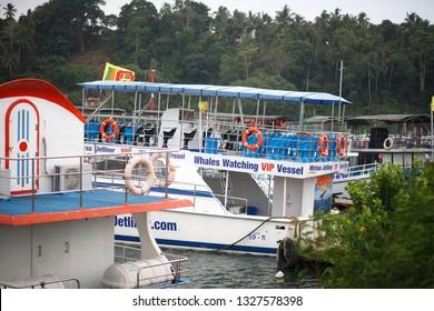 Mirissa, Sri Lanka - March, 25, 2018: Tourists boats in the Mirissa harbor.