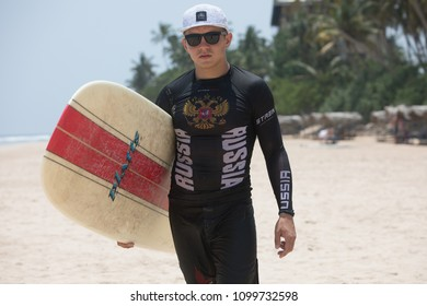 Mirissa/Sri Lanka - April 4, 2018: A man with a surfboard.