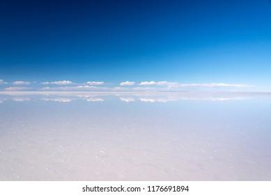 Miror effect and reflection of clouds in Salar de Uyuni (Uyuni salt flats), Potosi, Bolivia, South America