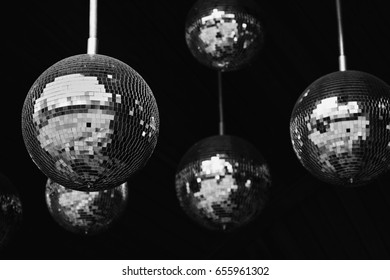 Mirror balls disco party abstract background. Black and white photo, shallow depth field