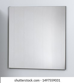 Mirror in a beautiful frame on a white background